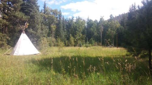 tipi in ceremony meadow